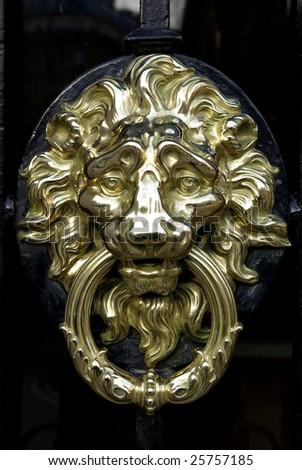 Typical Parisian door knocker in brass. - stock photo