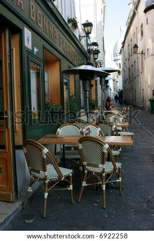 Typical Parisian outdoor cafe in Montmartre - stock photo