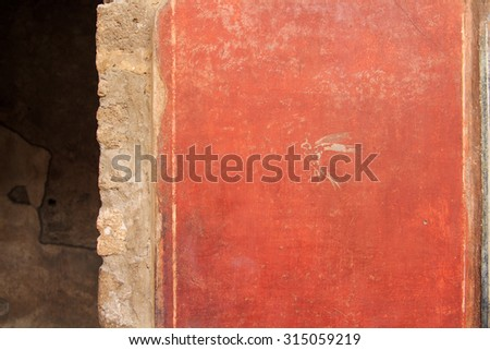 typical Pompeian red in Pompeii, Italy. Pompeii is an ancient Roman city died from the eruption of Mount Vesuvius in the 1st century. - stock photo