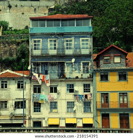 Typical Porto terraced housing on the Ribeira district quayside, overlooking the River Douro. instagram effect, vintage toned square image