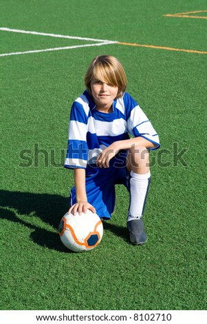 typical portrait of young soccer boy(all logos patterns removed or altered)