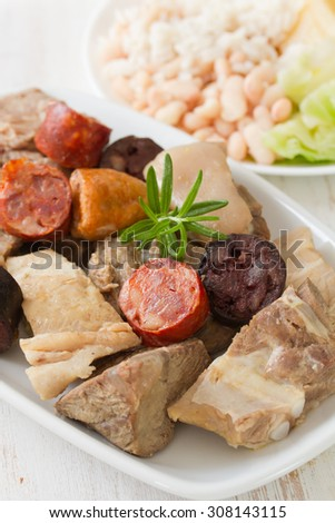 typical portuguese dish cozido a portuguesa and red wine