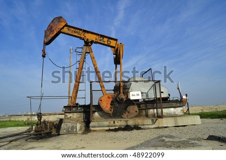 Typical pumping unit in a California oilfield - stock photo