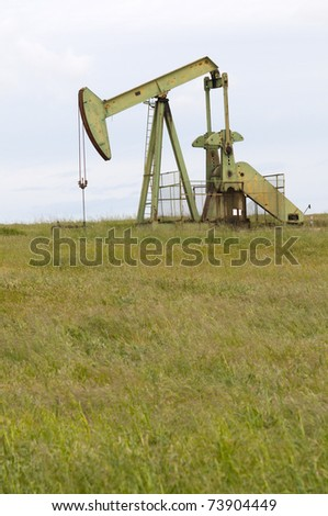 Typical pumping unit supplying crude oil for refining - stock photo