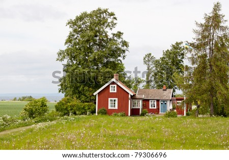 Typical red and white cottage in Sweden. - stock photo