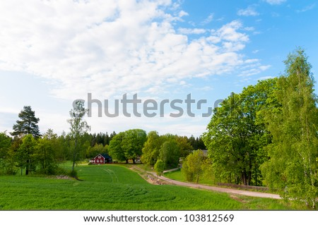 Typical red and yellow wooden houses in Ruda, province of Smaland, Sweden - stock photo