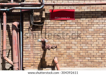 Typical red fire hydrant. on brick wall - stock photo