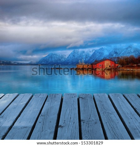 Typical red house on coast with platform dock - stock photo