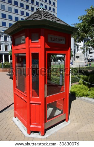 Typical red phone booth in Christchurch, Canterbury region, New Zealand - stock photo