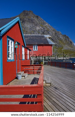 Typical red rorbu fishing huts on Lofoten islands in Norway - stock photo