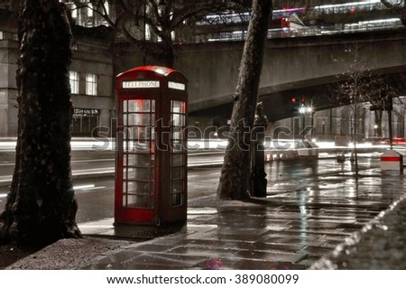 Typical red telephone box in London city in night. black and white colors and red box - stock photo