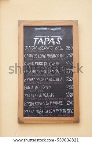 Typical Restaurant Tapas Menu in English and Spanish, Seville; Spain