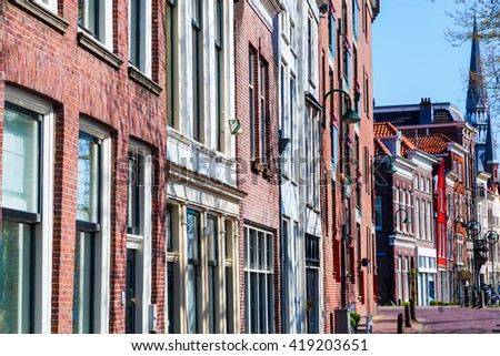 typical row houses along a canal in Gouda, Netherlands - stock photo