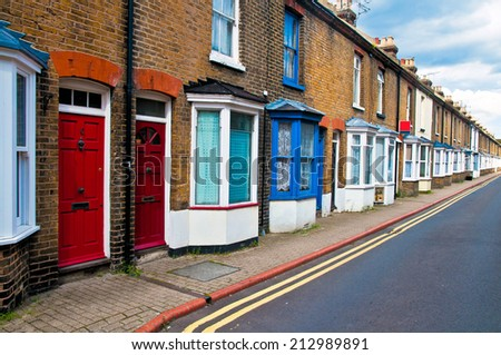 Typical row of english working man houses in Canterbury - stock photo