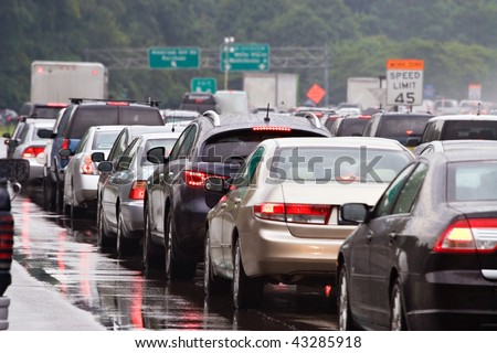 Typical scene during rush hour. A traffic jam with rows of cars waiting to get off the next exit.  Shallow depth of field. - stock photo