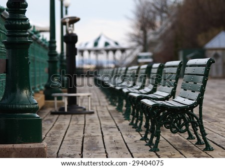Typical scene from Quebec City: The benches in front of Chateau Frontenac. - stock photo