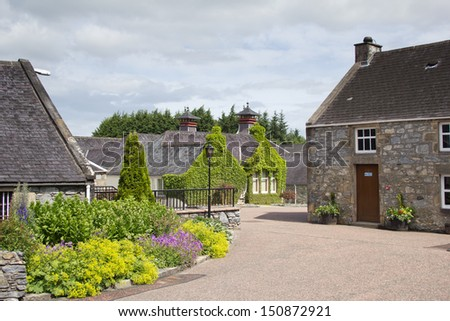 Typical Scottish whisky distillery building - stock photo