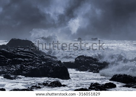 Typical sea storm from northern portuguese coast. Slightly enhanced sky. Toned blue. - stock photo