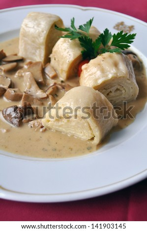 Typical Slovenian dish: Pancakes with cream cheese and mushrooms - stock photo