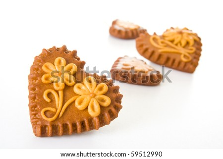 Typical Slovenian honeybread - heart shaped cookies on white background. - stock photo