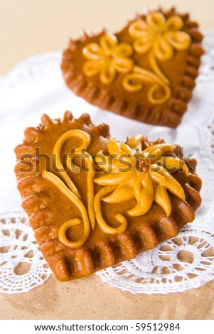 Typical Slovenian honeybread - heart shaped cookies on white lace. - stock photo
