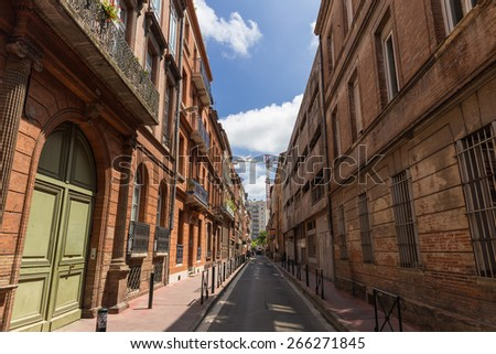 Typical small street and architecture in Toulouse - stock photo