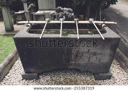 Typical source for purification in a Japanese temple   - stock photo