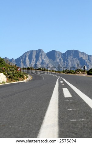 Typical South African mountain road in summer, shallow dof with copy space - stock photo