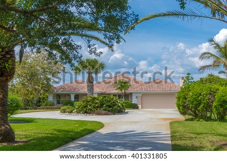 Typical Southwest Florida Concrete Block and Stucco Home.   - stock photo