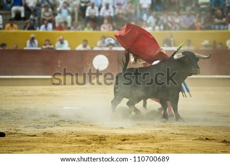 Typical Spanish bullfight in a traditional bullring - stock photo