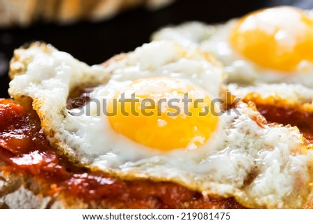 Typical spanish food tapas: Quail eggs and sobrada of Mallorca - stock photo