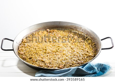 typical Spanish rice recipe called Paella due to the recipient in where it is cooked. In this case the recipe has sea foods - stock photo