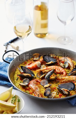 Typical spanish seafood paella in traditional pan - stock photo