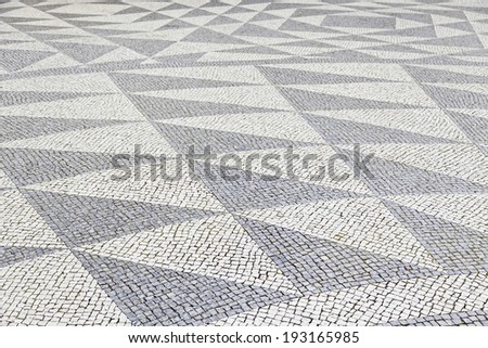 Typical stone floor Lisbon, detail of a typical floor with shapes and drawings, art Portugal, tourism - stock photo
