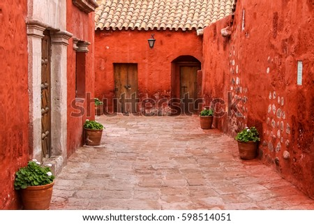 Typical street and painted buildings in historic Santa Catalina Monastery, Arequipa, Peru