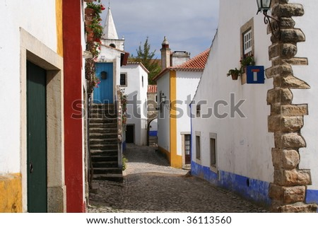Typical street in Obidos - stock photo