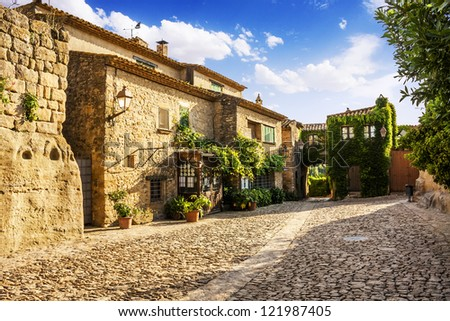 Typical street in Peratallada, medieval village, Catalonia, Spain - stock photo