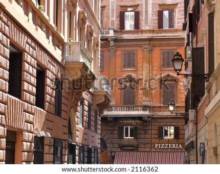 Typical street in Rome (Italy). Colorful buildings, Mediterranean architecture. - stock photo
