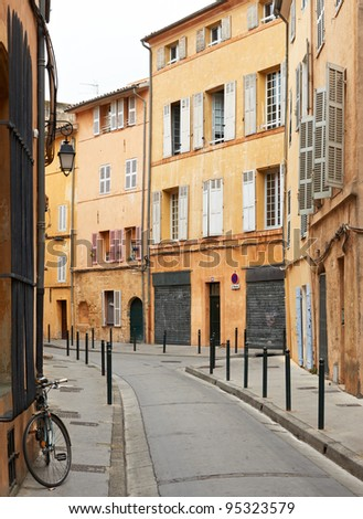 Typical street in the ancient part of Aix en Provence town, France - stock photo