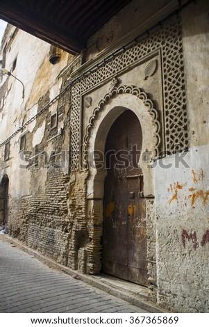 Typical street of Fez El Bali Medina. Fez, Morocco. North Africa. - stock photo