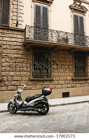 Typical street of old european town (Florence, Italy) - stock photo