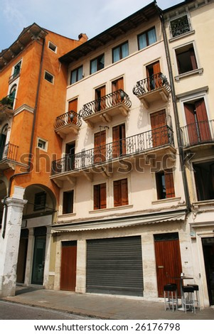 Typical street of old european town (Vicenza, Italy) - stock photo