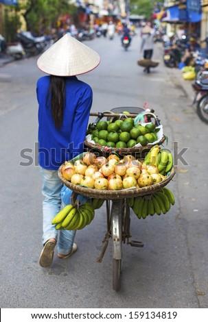Typical street vendor in Hanoi, Vietnam - stock photo