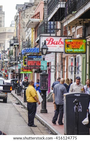 Typical street view at French Quarter New Orleans - NEW ORLEANS, LOUISIANA - APRIL 18, 2016  - stock photo