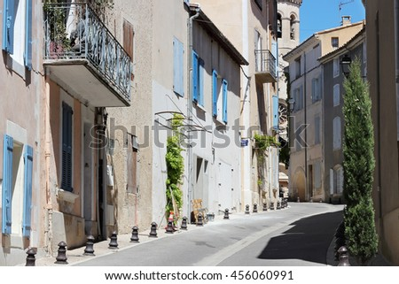 Typical street with old houses of a village in La Provence, wooden doors, windows, old street lamps, beautiful view, outdoors - stock photo