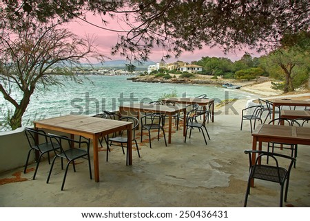 Typical terrace of a bar located in the coast of Porto Colom (Mallorca - Spain) - stock photo
