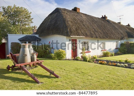 Typical Thatched Roof  Irish House in Adare - Ireland. - stock photo