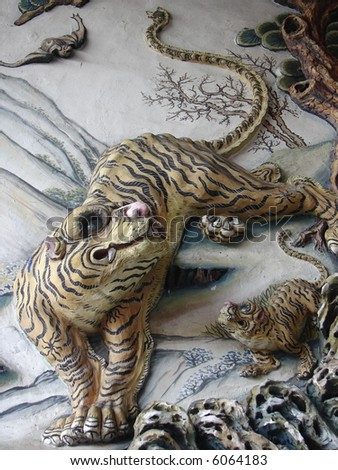 Typical tiger crafting & painting on the wall of chinese temple in Asia