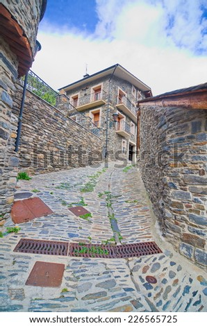 Typical traditional dark brick Andorra rural mountain houses in the village of Llorts near Andorra la Vella in the Pyrenees - stock photo