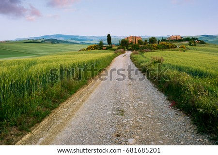 Typical tuscan farmhouse and green landscape in Italy, Europe